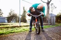 Dad Teaching Son to Ride Bike