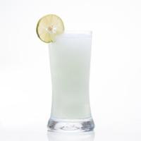Lemon juice smoothie shake in glass isolated