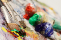 Artistic palette with colourful oil paints, creative still life