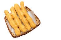 deep-fried dough stick in wooden basket