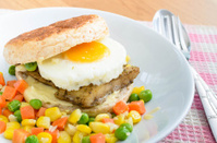 Fish Burger with fried eeg serving boiled mix vegetable