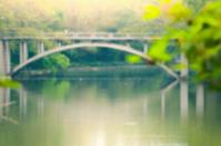 Arc stone bridge across the lake