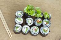 Sushi rolls on wooden desk