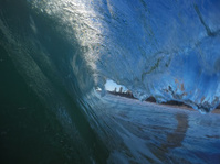 Blue wave about to break in blue water