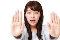 Japanese woman making stop gesture