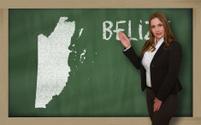 Teacher showing map of belize on blackboard