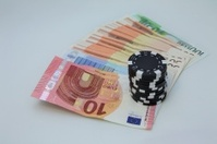 Poker chips on the money