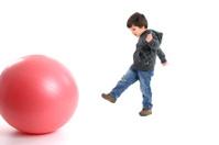 Kid kicking the ball