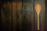 wood  spoon on wood  background dark brown.