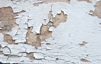 Peeling paint on old wood background