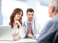 Medical team with elderly patient