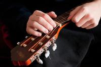 guitar stringing, close up