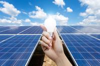 Solar energy panels and Light bulb in hand