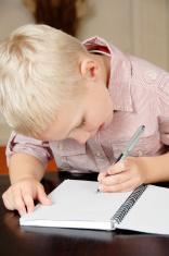 six year old boy writing