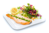 Salmon stake with green onion and salad mix