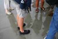Feet on the beach.