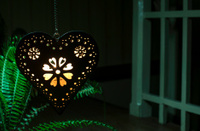 Heart shape and light from a candle