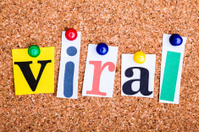 The word viral in cut out magazine letters