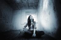 girl sitting on the floor crossing repairs