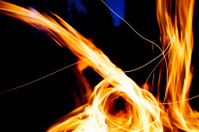 Beautifully dancing flames with a deep blue background