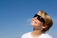 happy kid in sunglasses