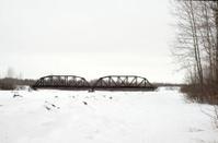 Winter scene with railroad bridge