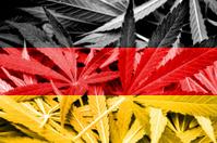 Germany Flag on cannabis background. Drug policy. Legalization o