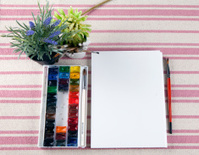 Beautiful composition of watercolor paints and brushes, album ar