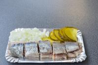 Sliced Dutch herring with gherkin