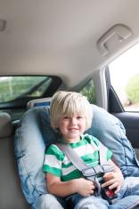 Little Boy In A Car Seat