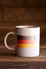 German Mug on Wooden Bckground