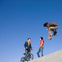 Skateboard tricks at park