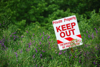 No Trespassing Sign in field