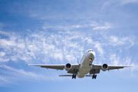Jet Aeroplane Landing From Blue Summer Sky