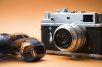 obsolete film camera with negatives