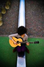 Girl Playing Guitar on Slide