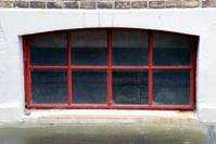 Red basement window