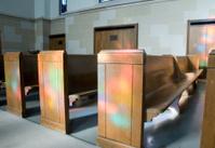 Lights Dance on Church Pews