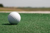 Golf ball on artificial grass