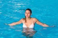 girl relaxing in a swimmingpool