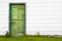 Grungy Green Door and White Wall