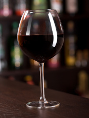 Glass of red wine at the bar