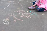 girl with  chalk on asphalt