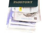 Passport, cash and boarding pass