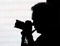 Pipe smoking photographer silhouette