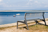 Bench with vista over the sea bay.