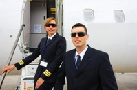 Young pilots before flight...captain and woman co-pilot