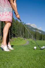 Golfer in high heels