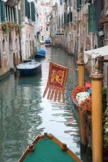Venetian Flag on Quiet Canal Venice Italy