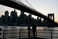 Brooklyn Bridge and Manhattan skyline At Sunset